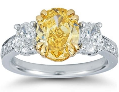 Fancy  Yellow Oval Diamond Three Stone Platinum Ring