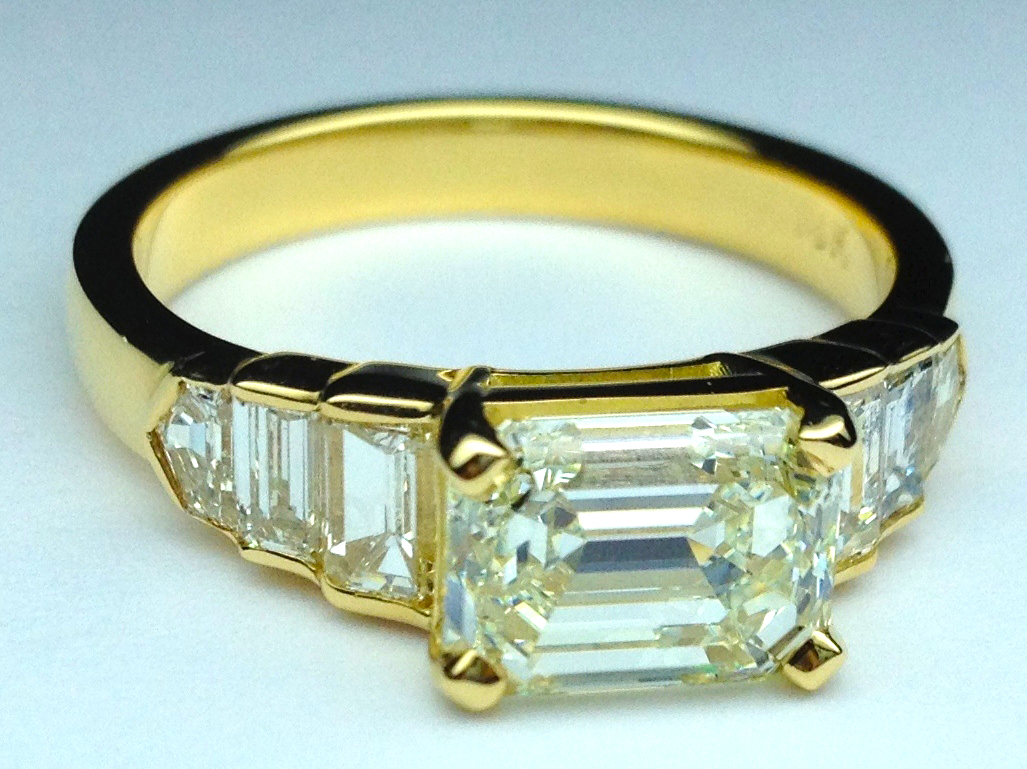 Horizontal Emerald Cut Diamond Step Up Engagement Ring Yellow Gold