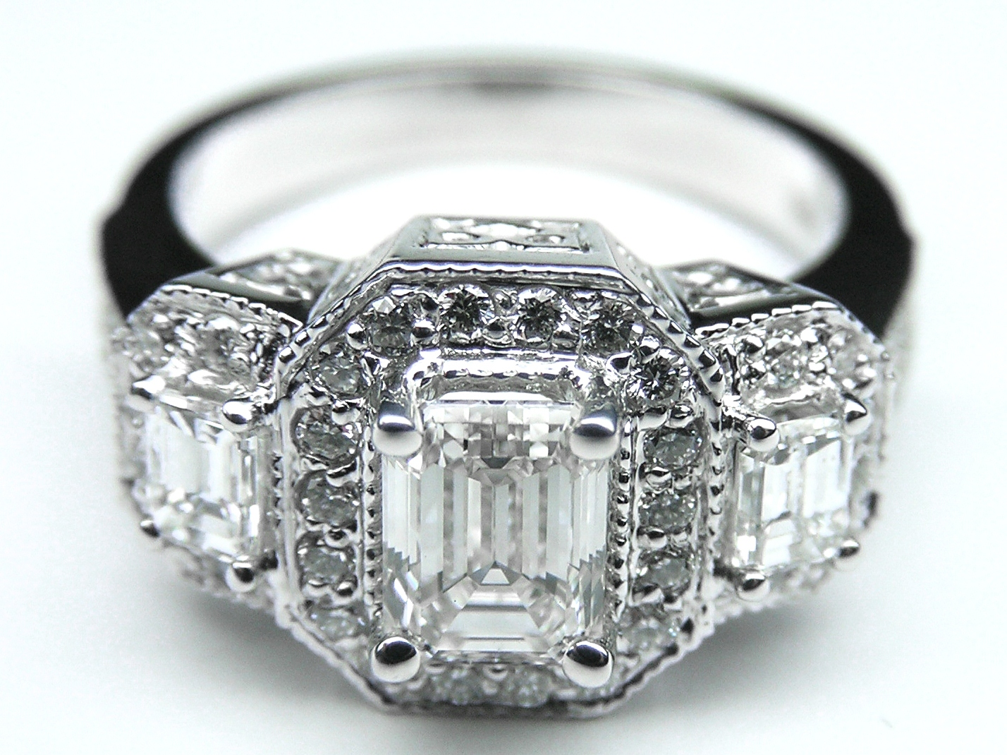 engagement ring -vintage style three stone emerald cut diamond