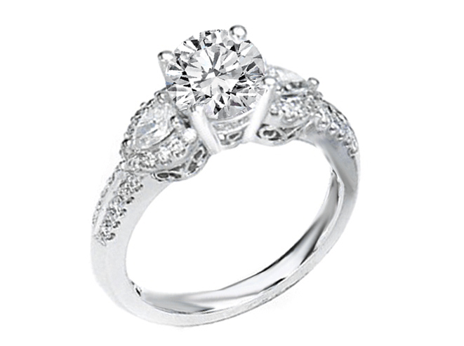 Diamond Engagement ring with pear shape side stones antique 0.84 tcw. In 14K White Gold