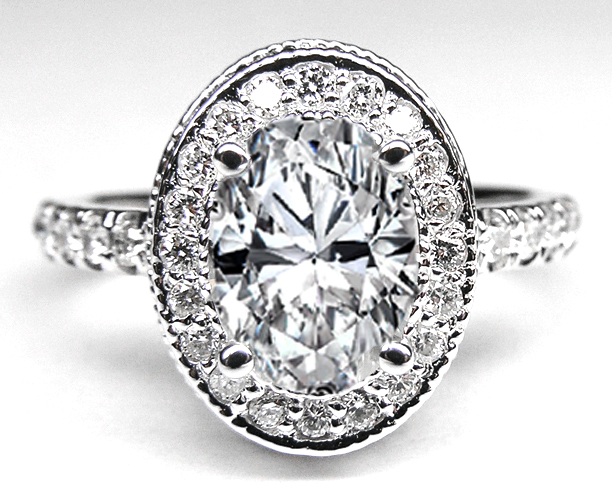 Oval Diamond Engagement Ring with double halo and Diamond band in 14K White Gold 0.52 tcw.