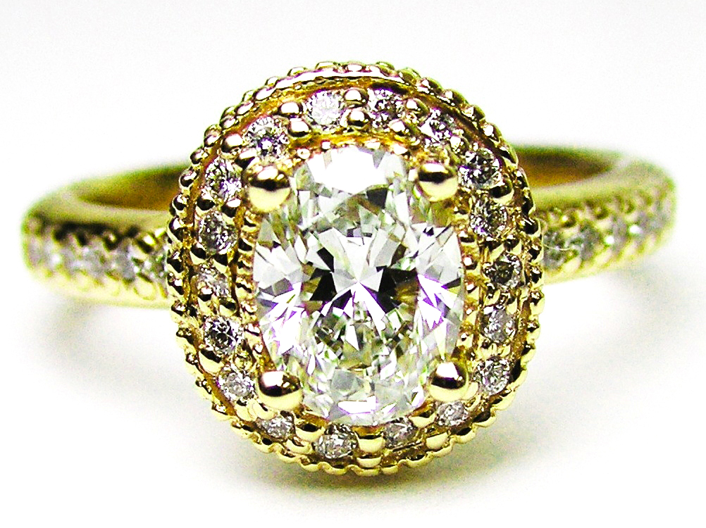 Oval Diamond Engagement Ring with double halo and diamond band in 14K Yellow Gold 0.52 tcw.