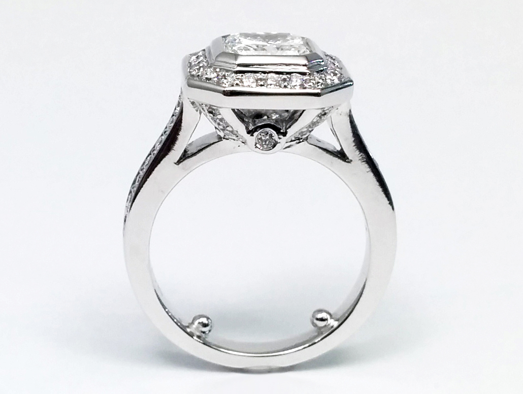 Radiant Cut Diamond bezel Cathedral Halo Engagement Ring 0.36 tcw. In 14K White Gold