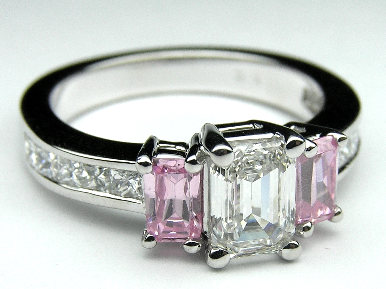 engagement ring emerald cut pink sapphires and princess