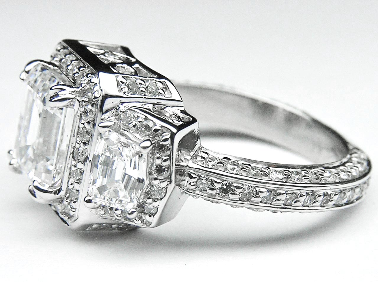 Emerald Diamond Vintage Design Halo Engagement Ring Cadillac trapezoids side stones in 14K White Gold