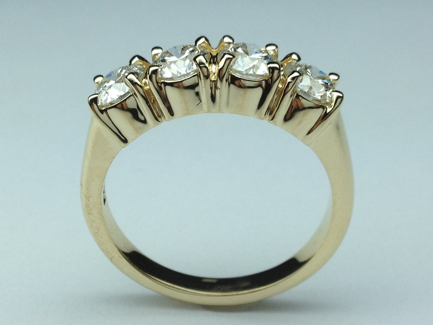 Four Stone Round Diamond Wedding Band in Yellow Gold